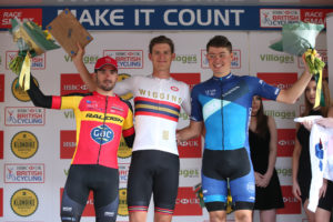 Harry Tanfield on the Klondike GP podium, with winner Chris Latham and Enrique Sanz